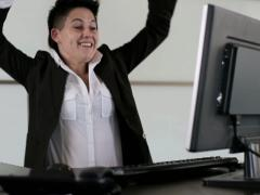 Excited punk businesswoman rasing hands in the office Stock Footage