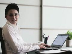 Portrait of smiling punk businesswoman in the office Stock Footage