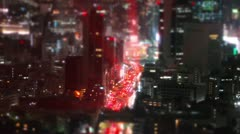 Zooming tilt-shift aerial time-lapse shot of Tokyo's busy city roads. - stock footage
