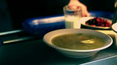 A dish of soup on the counter in the dining room Stock Footage