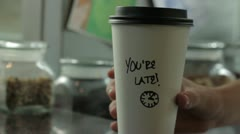 Coffee Cup That Says You're Late Stock Footage