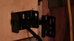 Wood door unlatching and swinging open Stock Footage