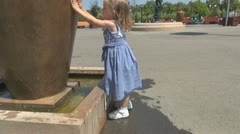 Child Playing with Water in Park Stock Footage