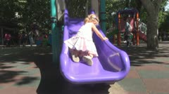 Child Sliding on a Slide in Park Stock Footage