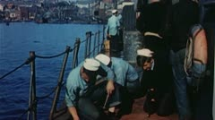 World War 2 color footage, soldiers working on ship Stock Footage
