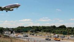 Passenger Plane low altitude fly by over freeway - stock footage
