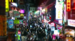 Harajuku tilt-shift & time-lapse shot of busy shopping street. - stock footage