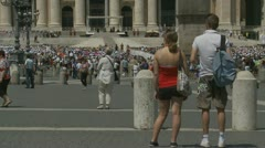 Young couple wonder which way out of Pope mass - stock footage