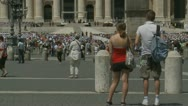 Young couple wonder which way out of Pope mass Stock Footage