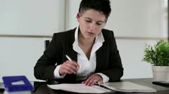 Young punk businesswoman signing documents in the office Stock Footage
