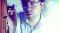 Chemistry chemical scientist science technology writing math equation glass Stock Footage