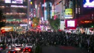 Stock Video Footage of Shibuya street crossing tilt-shift & time-lapse with slow zoom out.