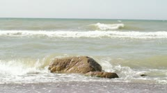 Stone in waves Stock Footage