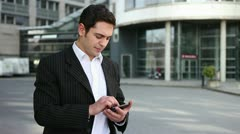Mann with phone holding thumbs up Stock Footage