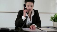 Young punk businesswoman talking on telephone in the office Stock Footage