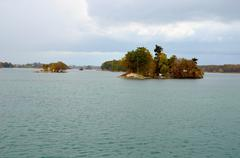 Thousand islands is the name of an archipelago of islands that straddle the c Stock Photos