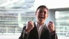 business man cheering with clenched fists - stock footage