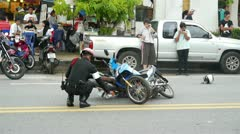 Policeman at the scene of motorbikes crash Stock Footage