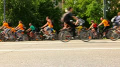 Many people ride on bicycles  (tilt-shift) - stock footage