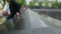 People gathered around 9/11 Memorial HD776 Stock Footage
