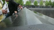 People gathered around 9/11 Memorial HD776 Stock Footage