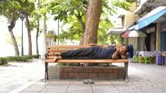 Homeless Man Sleeping on Bench on Sidewalk - stock footage