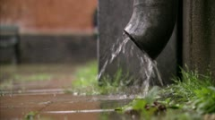 A drainpipe in the rain Stock Footage