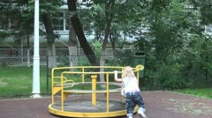 Child on a Merry Go Round in a Playground, Little Girl Playing, Children - stock footage