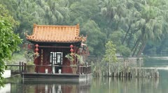 Traditional Chinese wooden hut in a lake Stock Footage
