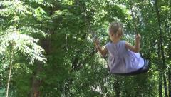 Child Swinging on a Swing Set in a Playground Stock Footage