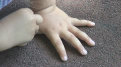 Child Drawing, Tracing Hand with Chalk on Asphalt, Little Girl Playing, Children - stock footage