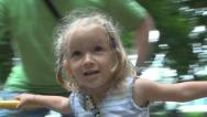 Child Spinning in a Merry Go Round at Playground, Little Girl Playing, Children Stock Footage