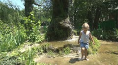 Child Playing with Water in Park, Little Girl Splashing, Children  Stock Footage
