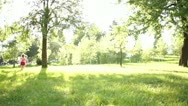 Children running around on the lawn Stock Footage