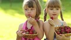 Happy kids eat strawberries Stock Footage
