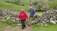 Walkers on dales way footpath, grassington Stock Footage