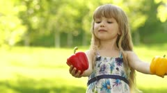 Child invites the viewer to a healthy diet vegetables Stock Footage