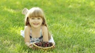 Stock Video Footage of Child lying on the grass with a sweet cherry fruit
