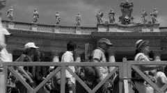 Pilgrims leave Pope's mass at St Peters (4) slow motion B&W - stock footage