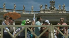 Pilgrims leave Pope's mass at St Peters (3) slow motion Stock Footage