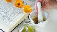 Preparing Calendula Oil with A Mortar Stock Footage