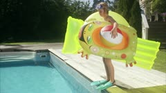 WS TU Portrait of girl with inflatable toys on poolside - stock footage