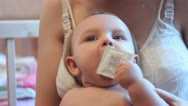 Stock Video Footage of Baby plays with a condom