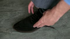 Tying a shoelace Stock Footage