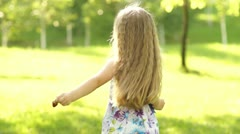 Girl with strawberry spinning Stock Footage