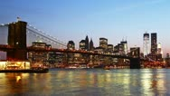 Beautiful view of Manhattan skyline and Brooklyn bridge at sunset. Time lapse Stock Footage