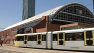 Gmex centre with metrolink tram and beetham tower, manchester, england Stock Footage