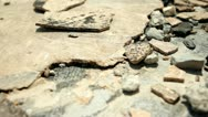 Broken tile and rock debris dolly shot Stock Footage