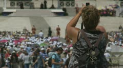 Lady takes photo at Papal mass in Rome - stock footage