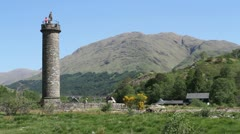 Tourists at top of Glenfinnan Monument Scotland Stock Footage